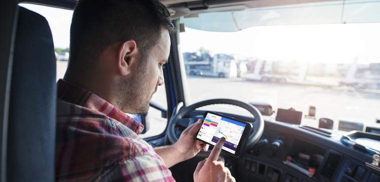 Truck driver checking his route against Trip Polices